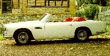 Aston Martin DB4 Convertible (1963, white bodywork, side view)