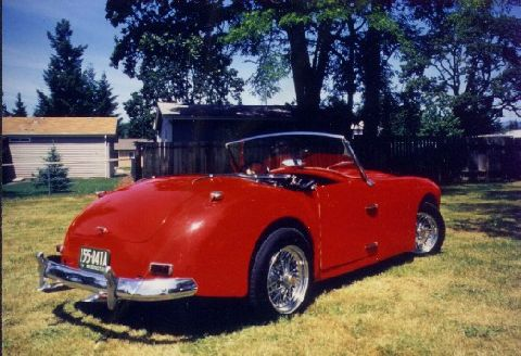 Here are some pictures of my Allard Palm Beach, s/n 21Z 5119.  Note that the grill on my car is the correct buffed aluminum panels rather than the painted ones on the example you have pictured. Engine