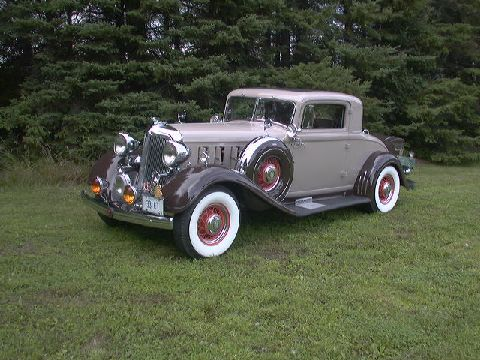 The car is a restored 1933 Chrysler Royal Eight CT rumble seat coup with dual sidemounts. Numerous after market accessories have been added, each correct for the time period of the car.