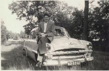 This is my dad in the fifties, on his Plymouth Cranbrook.