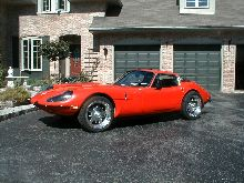 1972 3 litre Volvo Marcos #5838 with original Porsche tangerine paint, upgraded 230 hp engine.