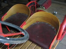 1925 Auto Red buck front seats