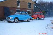blue DKW and a red 2CV