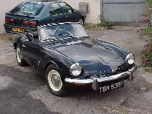 Triumph Spitfire Mk III (dark blue bodywork, left-front view)