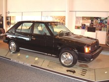 1986 Dodge Omni Shelby GLHS 4-Door Black svr 1st Floor (WPC Museum) F