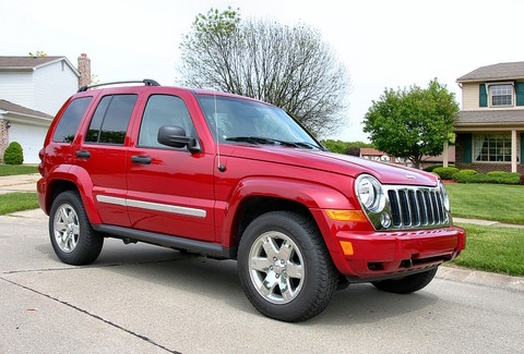 2006 Jeep Liberty Limited in Front of House Inferno Red lfvr CL